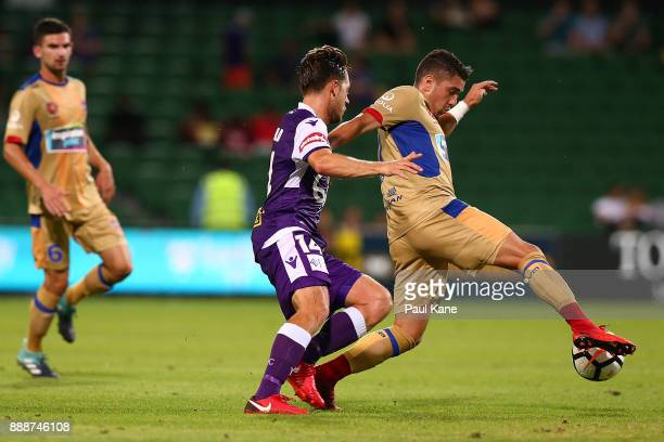 Dimitri Petratos of the Jets controls the ball against Chris Harold of the Glory during the round 10 ALeague match between the Perth Glory and the...