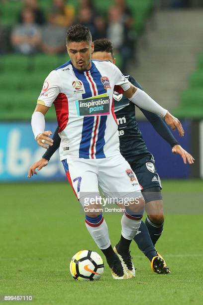 Dimitri Petratos of the Jets controls the ball under pressure during the round 13 ALeague match between the Melbourne Victory and the Newcastle Jets...