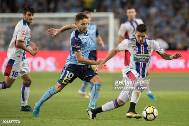 Dimitri Petratos of the Jets gets past Sydney FC's Milos Ninkovic during the round fourteen ALeague match between the Sydney FC and Newcastle Jets FC...