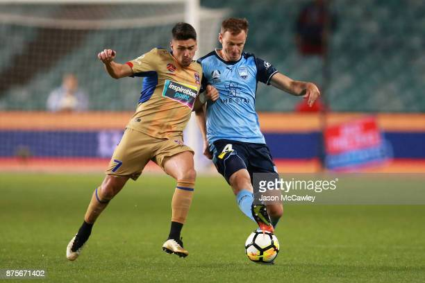 Dimitri Petratos of the Jets is challenged by Alex Wilkinson of Sydney during the round seven ALeague match between Sydney FC and Newcastle Jets at...