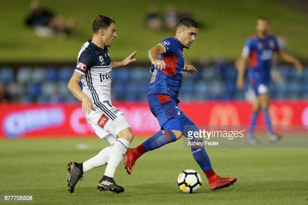 Dimitri Petratos of the Jets is contested by James Troisi of the Victory during the round eight ALeague match between the Newcastle Jets and the...