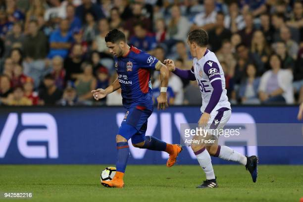 Dimitri Petratos of the Jets is contested by Neil Kilkenny of Perth Glory during the round 26 ALeague match between the Newcastle jets and the Perth...