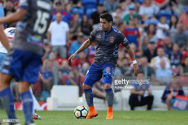 Dimitri Petratos of the Jets is contested by the Sydney FC defence during the round 22 ALeague match between the Newcastle Jets and Sydney FC at...