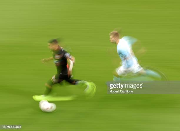 Dimitri Petratos of the Jets runs with the ball during the round six ALeague match between Melbourne City and the Newcastle Jets at AAMI Park on...