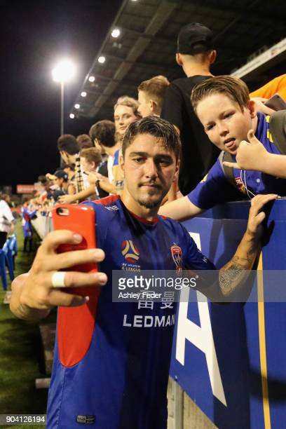 Dimitri Petratos of the Jets takes a selfie with fans after winning during the round 16 ALeague match between the Newcastle Jets and the Brisbane...
