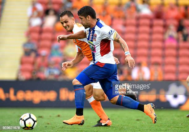 Dimitri Petratos of the Jets takes on the defence during the round 21 ALeague match between the Brisbane Roar and the Newcastle Jets at Suncorp...
