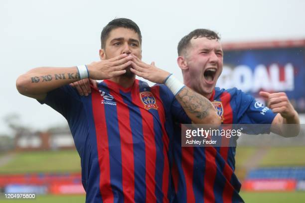 Dimitri Petratos of the Newcastle Jets celebrates his goal with team mate Bobby Burns during the round 18 A-League match between the Newcastle Jets...