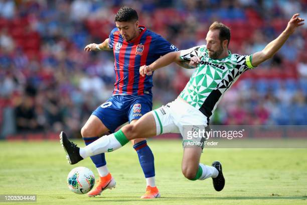 Dimitri Petratos of the Newcastle Jets contests the ball against Andrew Durante of Western United during the round 17 A-League match between the...