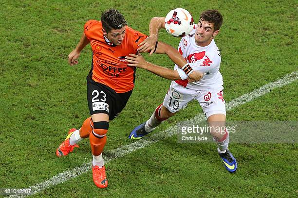 Dimitri Petratos of the Roar and Benjamin Garuccio of the Heart compete for the ball during the round 25 ALeague match between Brisbane Roar and...