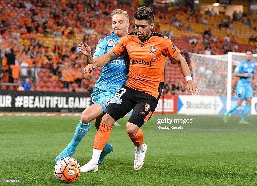 Dimitri Petratos of the Roar and James Jeggo of Adelaide challenge for the ball during the round four A-League match between Brisbane Roar and Adelaide United at Suncorp Stadium on October 31, 2015 in Brisbane, Australia.