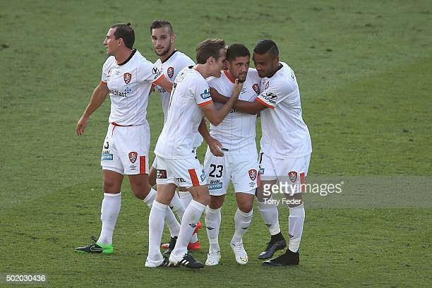 Dimitri Petratos of the Roar celebrates a goal with team mates during the round 11 ALeague match between the Central Coast Mariners and the Brisbane...