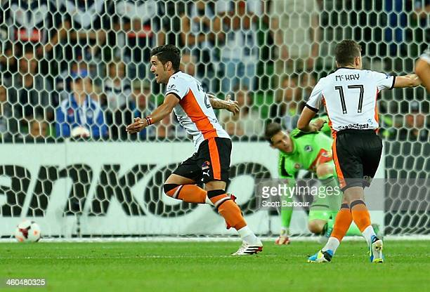 Dimitri Petratos of the Roar celebrates after scoring a goal during the round 13 ALeague match between the Melbourne Victory and Brisbane Roar at...