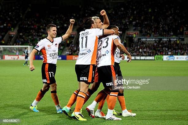 Dimitri Petratos of the Roar celebrates his goal with his teammates during the round 13 ALeague match between the Melbourne Victory and Brisbane Roar...
