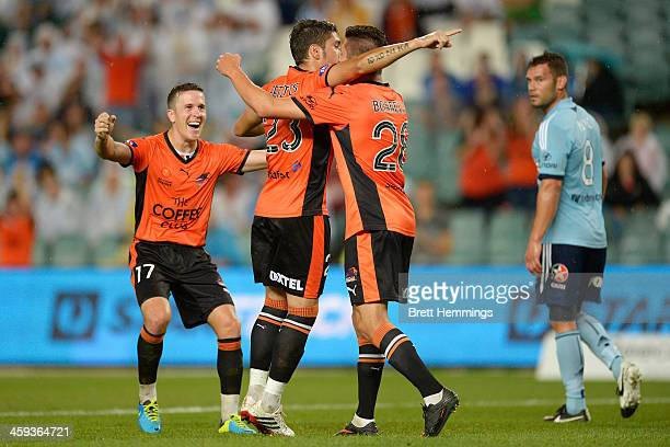 Dimitri Petratos of the Roar celebrates scoring a hatrick with team mates during the round 12 ALeague match between Sydney FC and Brisbane Roar at...