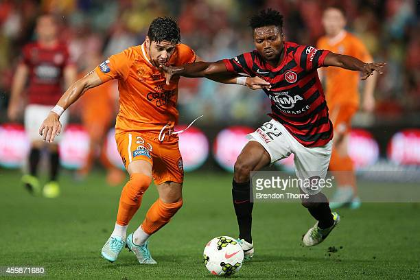 Dimitri Petratos of the Roar competes with Seyi Adeleke of the Wanderers during the round four ALeague match between the Western Sydney Wanderers and...