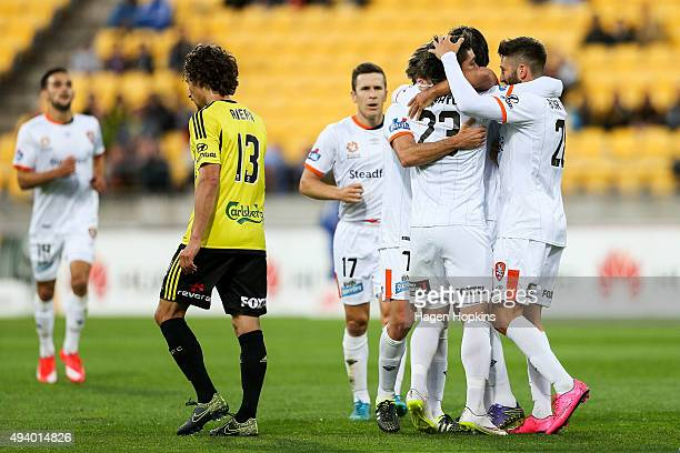Dimitri Petratos of the Roar is congratulated on his goal by Brandon Borrello of the Roar during the round three ALeague match between the Wellington...