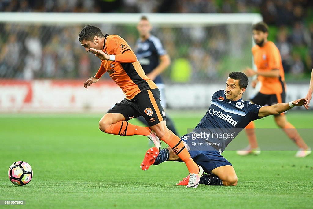 Dimitri Petratos of the Roar is tackled by Daniel Georgievski of the Victory during the round 15 A-League match between the Melbourne Victory and the Brisbane Roar at AAMI Park on January 13, 2017 in Melbourne, Australia.