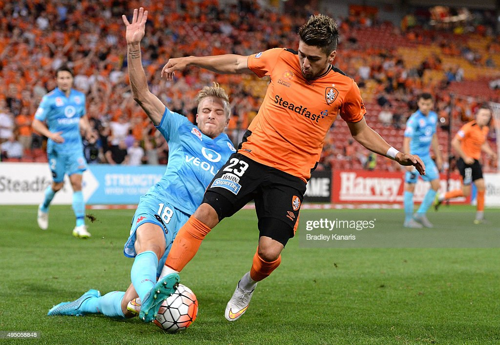 Dimitri Petratos of the Roar is tackled by James Jeggo of Adelaide during the round four A-League match between Brisbane Roar and Adelaide United at Suncorp Stadium on October 31, 2015 in Brisbane, Australia.