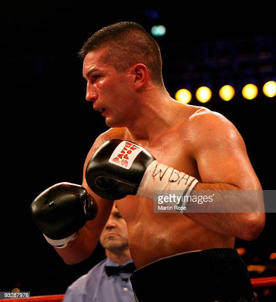 Dimitri Sartison of Germany in action during the WBA super middleweight world championship fight during the Universum Champions night boxing at the...