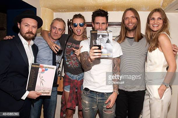 Dimitri Scheblanov Jesper Carlsen Behati Prinsloo Adam Levine James Valentine and Heidi Verster attend the launch party for Herring Herring Framed...