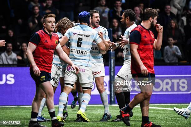Dimitri Szarzewski and Remi Tales of Racing celebrates a try during the Champions Cup match between Racing 92 and Munster at U Arena on January 14...