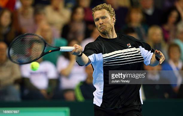 Dimitri Tursunov of Russia in action in his match against Dan Evans of Great Britain during day one of the Davis Cup match between Great Britain and...