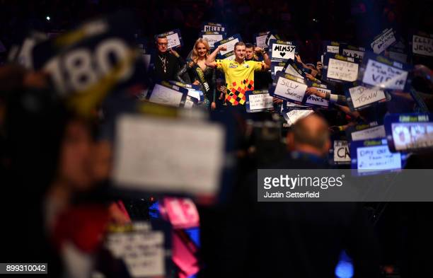 Dimitri Van Den Bergh iarrives for his Third Round Match against Mensur Suljovic during the 2018 William Hill PDC World Darts Championships on Day...