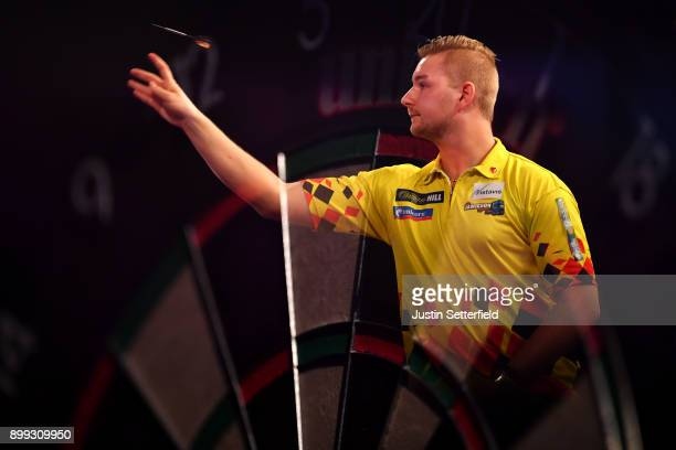 Dimitri Van Den Bergh in action during his Third Round Match against Mensur Suljovic during the 2018 William Hill PDC World Darts Championships on...