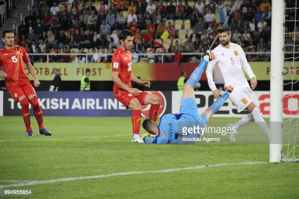Dimitrievski of Macedonian National Football Team in action against Pique of Spanish National Football Team during the FIFA 2018 World Cup Qualifiers...