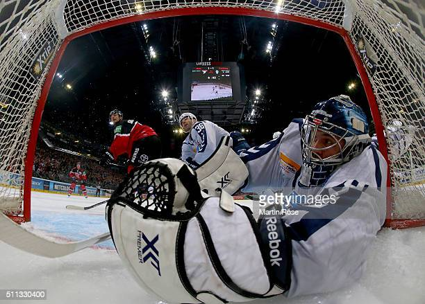 Dimitrij Kotschnew goaltender of Hamburg Freezers slides into the net during the DEL Ice Hockey match between Koelner Haie and Hamburg Freezers at...