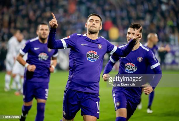 Dimitrij Nazarov of Aue celebrates after scoring his team's second goal during the Second Bundesliga match between FC Erzgebirge Aue and FC St. Pauli...