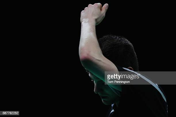 Dimitrij Ovtcharov of Germany reacts after giving up a point to Vladimir Samsonov of Belarus during the Men's Singles Quarterfinal 3 Table Tennis on...