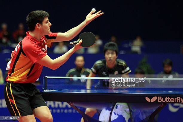Dimitrij Ovtcharov of Germany serves during his match against Jun Mitzutani of Japan during the LIEBHERR table tennis team world cup 2012...