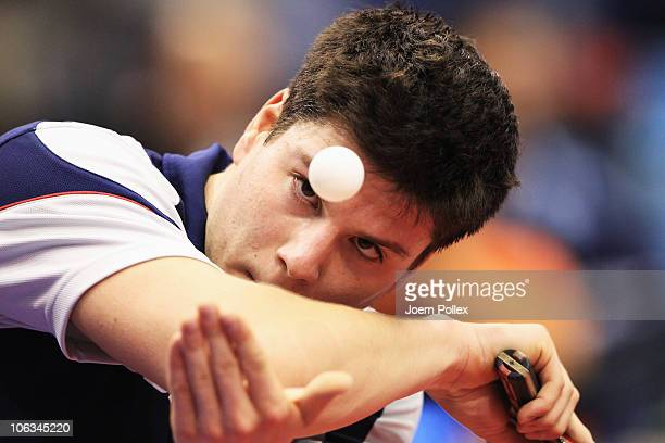 Dimitrij Ovtcharov of Germany serves to Kalinikos Kreanga of Greece during their Table Tennis World Cup 2010 match at the Boerdeland Hall on October...