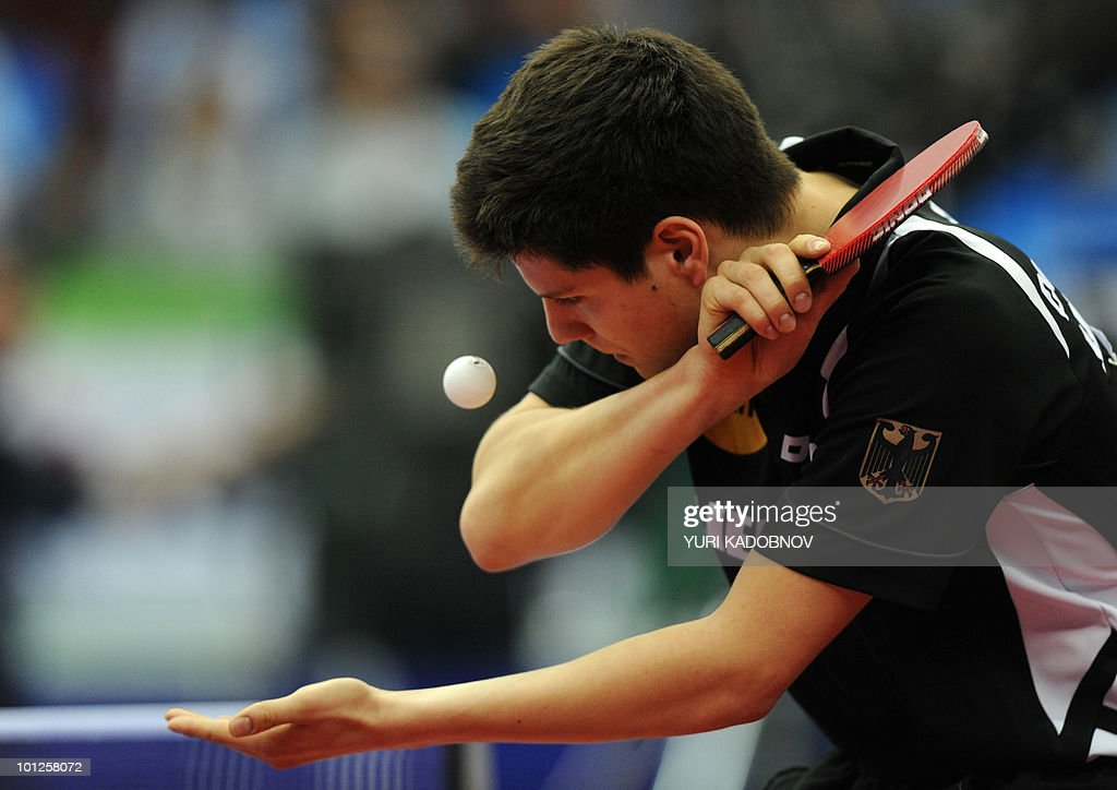 Dimitrij Ovtcharov of Germany serves to Seung Min Ryu of Korea during the men's semi final at the 2010 World Team Table Tennis Championships in Moscow on May 29, 2010.