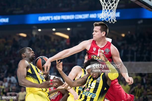Dimitrios Agravanis #10 of Olympiacos Piraeus competes with Bobby Dixon #35 of Fenerbahce Istanbul and Ekpe Udoh #8 of Fenerbahce Istanbul during the...