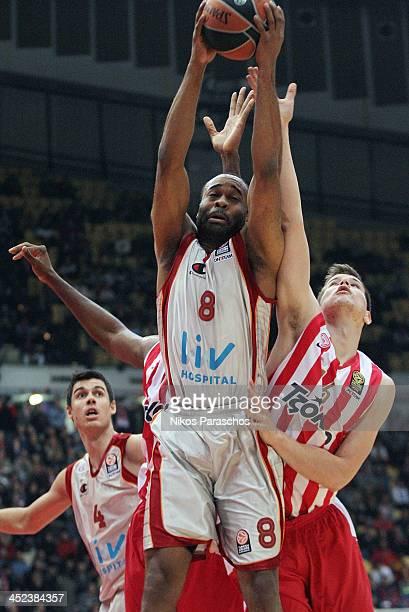 Dimitrios Agravanis #16 of Olympiacos Piraeus competes with Malik Samory Hairston #8 of Galatasaray Liv Hospital Istanbul during the 20132014 Turkish...