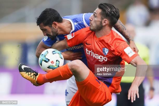 Dimitrios Diamantakos of Bochum is challenged by Aytac Sulu of Darmstadt during the Second Bundesliga match between SV Darmstadt 98 and VfL Bochum...