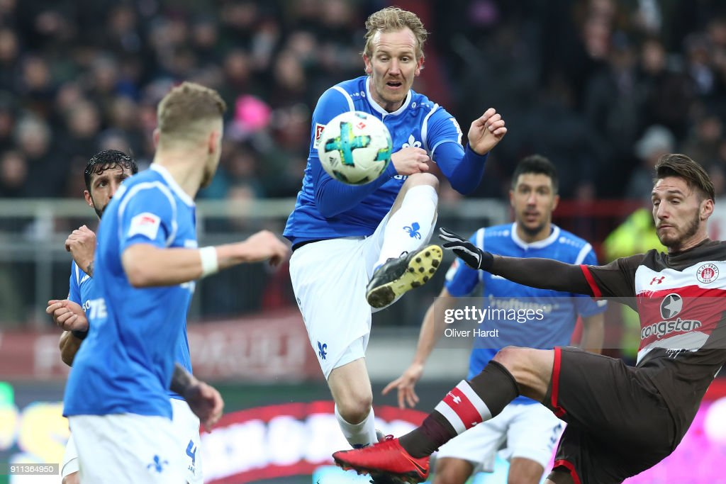 Dimitrios Diamantakos (R) of Pauli and Jan Rosenthal (L) of Darmstadt compete for the ball during the Second Bundesliga match between FC St. Pauli and SV Darmstadt 98 at Millerntor Stadium on January 28, 2018 in Hamburg, Germany.