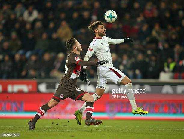 Dimitrios Diamantakos of St Pauli and Enrico Valentini of Nuernberg battle for the ball during the Second Bundesliga match between FC St Pauli and 1...