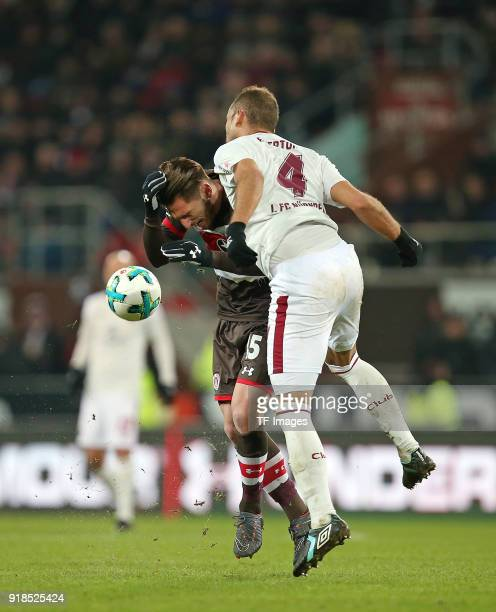 Dimitrios Diamantakos of St Pauli and Ewerton of Nuernberg battle for the ball during the Second Bundesliga match between FC St Pauli and 1 FC...