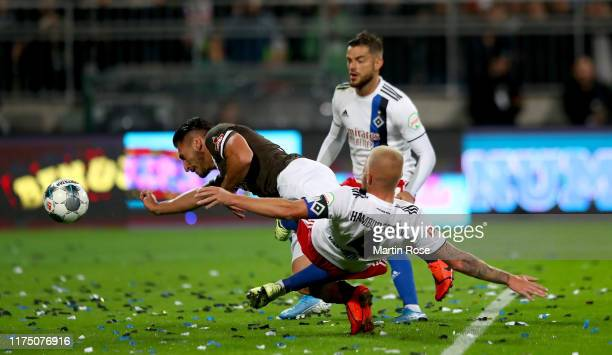 Dimitrios Diamantakos of St. Pauli challenges heads the opening goal during the Second Bundesliga match between FC St. Pauli and Hamburger SV at...