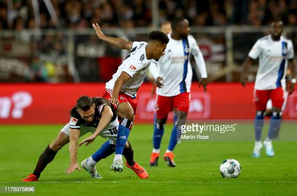 Dimitrios Diamantakos of St. Pauli challenges Josha Vagnoman of Hamburg during the Second Bundesliga match between FC St. Pauli and Hamburger SV at...