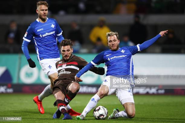 Dimitrios Diamantakos of St Pauli is challenged by Tim Rieder of Darmstadt during the Second Bundesliga match between SV Darmstadt 98 and FC St Pauli...