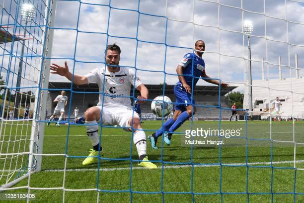 Dimitrios Diamantakos of St. Pauli scores his team's first goal ahead of David Pisot of Karlsruhe during the Second Bundesliga match between...