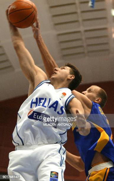 Dimitrios Diamantidis from Greece struggles to control a loose ball with Stanislav Balashov from Ukraine during their match in group D of the FIBA...