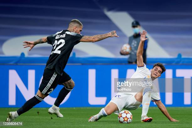 Dimitrios Kolovos of Sheriff and Miguel Gutierrez of Real Madrid compete for the ball during the UEFA Champions League group D match between Real...