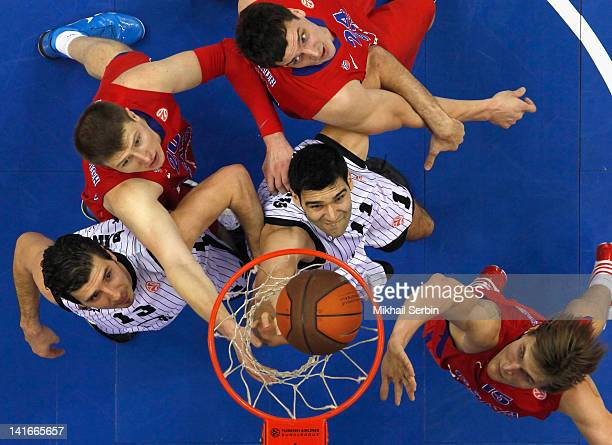 Dimitrios Mavroeidis and Marko Banic of Gescrap BB compete with Andrey Vorontsevich Alexander Kaun and Andrei Kirilenko of CSKA Moscow during the...