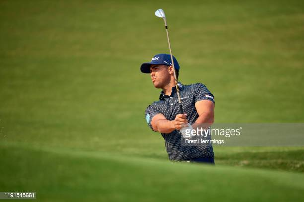 Dimitrios Papadatos of Australia chips onto the 18th green during a practice round ahead of the 2019 Australian Golf Open at The Australian Golf Club...
