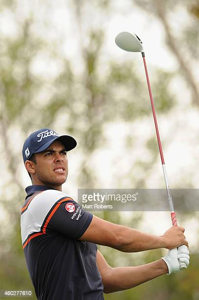 Dimitrios Papadatos of Australia watches his tee shot on the 10th hole during day one of the 2014 Australian PGA Championship at Royal Pines Resort...